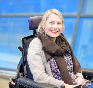 Status etter 20 år i arbeid, med hjelp av elektrisk rullestol og funksjonsassistanse